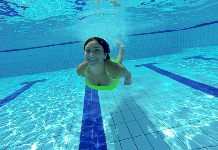 Happy woman underwater swimming