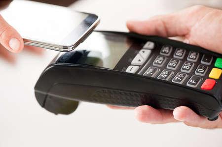 Photo pour - NFC - Near field communication mobile payment - image libre de droit