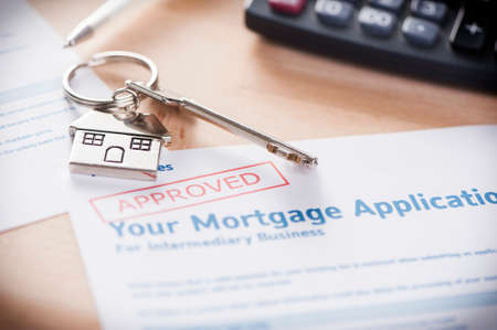Photo for Approved Mortgage loan application with house key - Royalty Free Image
