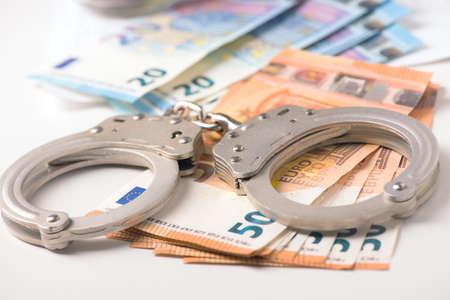 Foto de Handcuff and euro money. Crime fraud concept - Imagen libre de derechos
