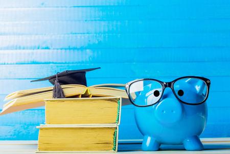 Foto de College graduate student diploma piggy bank - Imagen libre de derechos