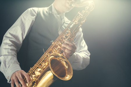 Photo for Young man playing the Saxophone - Royalty Free Image