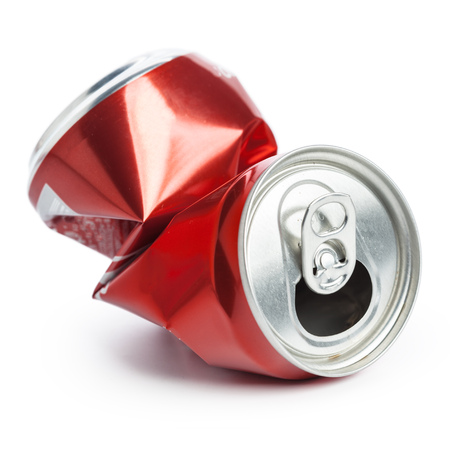 Foto de Compressed cans isolated on a white background - Imagen libre de derechos