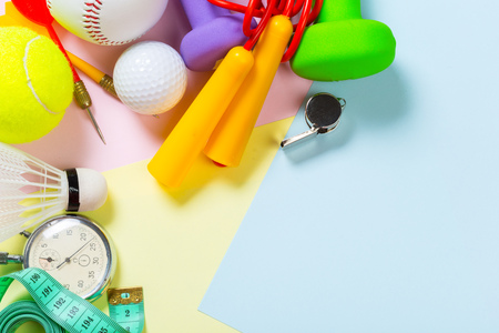 Assorted sports equipment on colored background