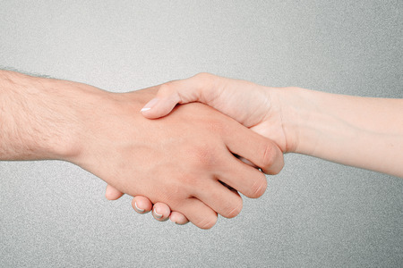 Photo for Shaking hands of two people - Royalty Free Image