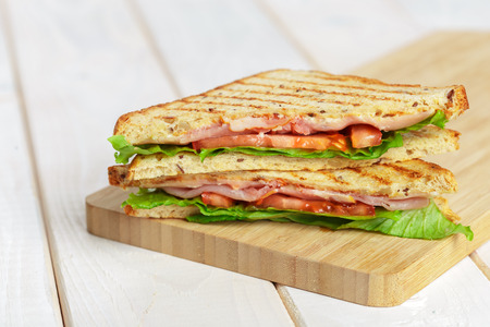 Photo for Club sandwich on wooden table - Royalty Free Image