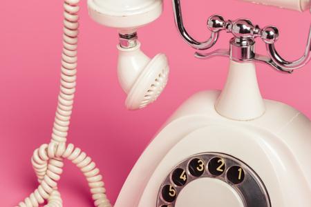 Foto de Retro white telephone on pink background - Imagen libre de derechos