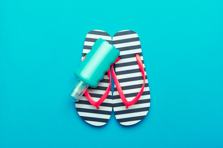 Photo for Beachwear and accessories on a blue background - Royalty Free Image