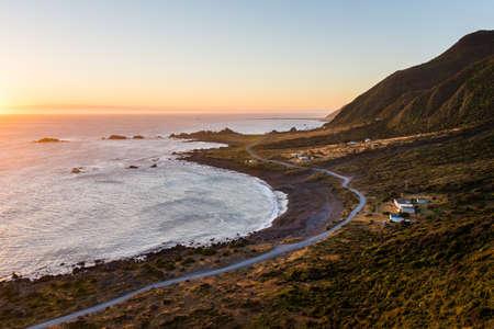 Foto de Palliser Bay sunset, New Zealand - Imagen libre de derechos