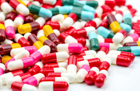Foto de Selective focus on colorful of antibiotic capsules pills on blur background with copy space. Drug resistance concept. Antibiotics drug use with reasonable and global healthcare concept. - Imagen libre de derechos