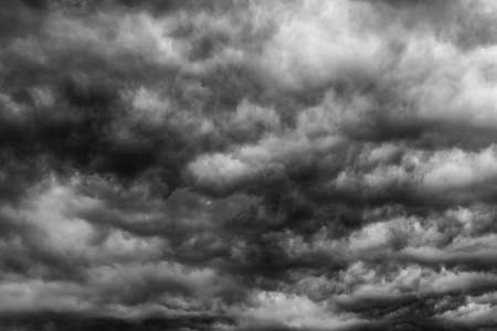 Photo pour Dramatic dark sky and clouds. Cloudy sky background. Black sky before thunder storm and rain. Background for death,  sad, grieving or depression. - image libre de droit