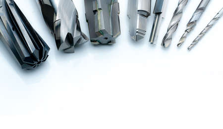 Foto de Special tools isolated on white background. Made to order special tools. Coated step drill and reamer detail. HSS cemented carbide. Carbide cutting tool for industrial applications. Engineering tools. - Imagen libre de derechos