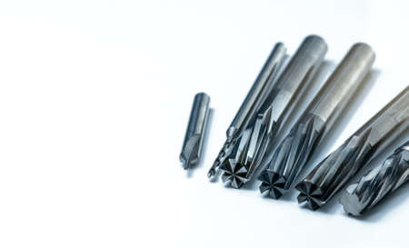 Foto de Special tools isolated on white background. Made to order special tools. Coated step drill, reamer, and endmill detail. HSS cemented carbide. Carbide cutting tool for industrial applications. - Imagen libre de derechos