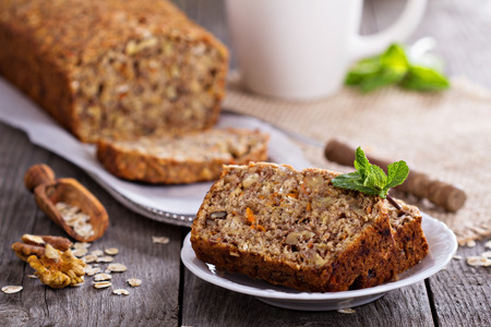 Photo for Vegan banana carrot bread with oats and nuts - Royalty Free Image