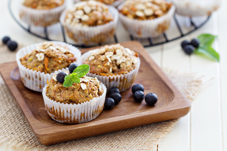 Photo for Vegan banana carrot muffins with oats and berries - Royalty Free Image