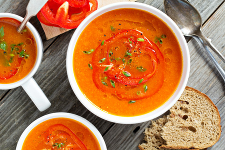 Photo for Roasted red pepper soup in white bowl - Royalty Free Image