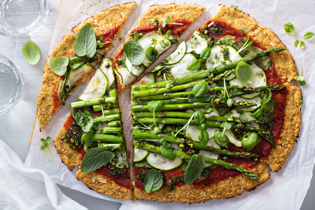 Photo for Cauliflower green pizza with spinach, zucchini and asparagus - Royalty Free Image