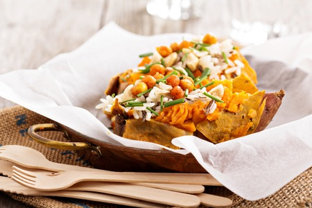 Photo for Baked sweet potato stuffed with rice, chives and roasted chickpeas - Royalty Free Image