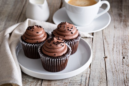 Photo for Chocolate cupcakes with a cup of hot black coffee - Royalty Free Image