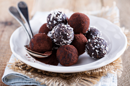 Photo for Healthy chocolate truffles with nuts and dates - Royalty Free Image