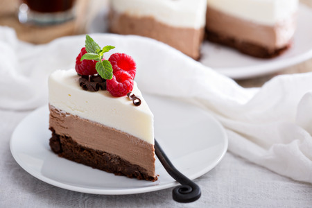 Photo for Three chocolate mousse cake slice on a small plate - Royalty Free Image