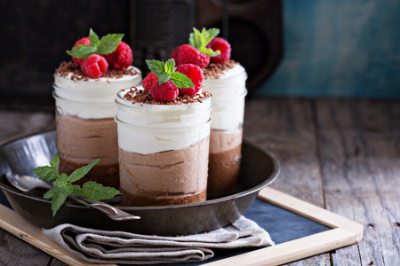 Photo for Three chocolate mousse dessert in mason jars - Royalty Free Image