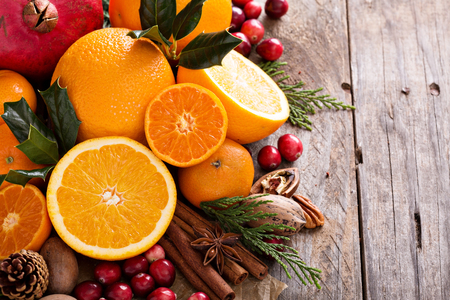 Photo for Fall and winter ingredients still life with oranges, cranberry, nuts and spices - Royalty Free Image