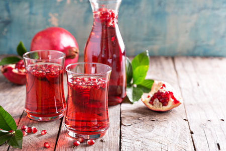 Photo for Pomegranate drink with sparkling water fall cold beverage - Royalty Free Image