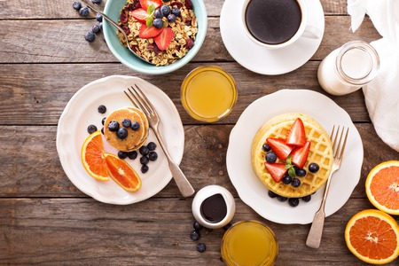 Photo for Breakfast table with waffles, granola and fresh berries - Royalty Free Image
