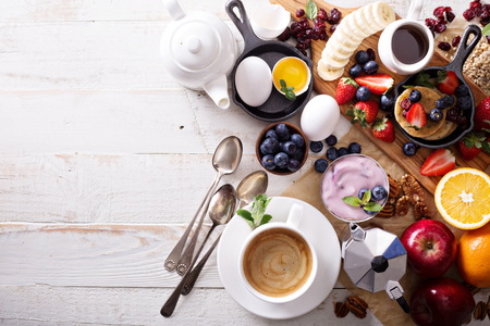 Photo pour Colorful and tasty breakfast ingredients on white table - image libre de droit