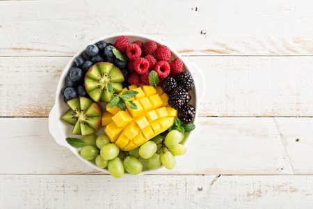 Photo for Fruit plate with variety of berries, mango and kiwi - Royalty Free Image