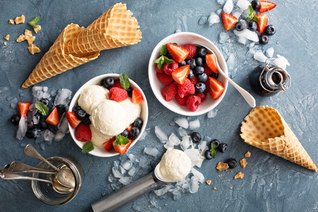 Photo for Vanilla ice cream scoops with fresh berries overhead shot - Royalty Free Image