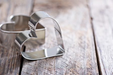 Foto de Heart shaped cookie cutter on wooden table, Valentines day baking concept - Imagen libre de derechos