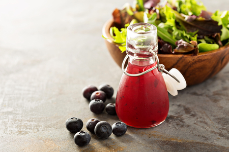 Photo for Blueberry vinaigrette salad dressing in small bottle - Royalty Free Image