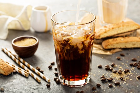 Photo for Iced coffee being poured in a glass - Royalty Free Image