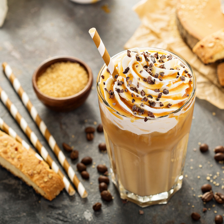 Photo for Iced caramel latte coffee in a tall glass - Royalty Free Image