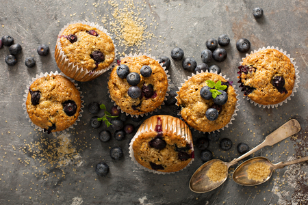 Photo for Healthy vegan banana blueberry muffins with fresh berries overhead shot - Royalty Free Image