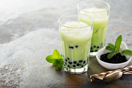 Photo for Matcha bubble tea with tapioca pearls in tall glasses - Royalty Free Image