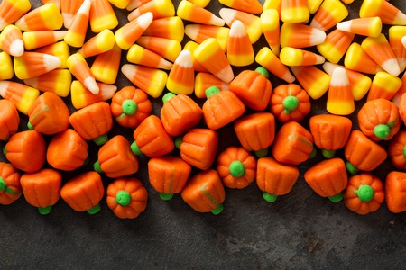 Foto de Candy corn and pumpkin Halloween background - Imagen libre de derechos