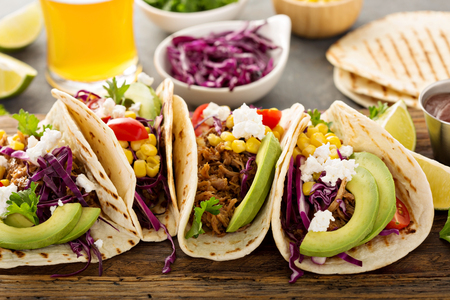Photo for Pulled pork tacos with red cabbage and avocados - Royalty Free Image