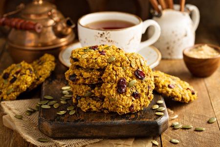 Foto de Breakfast oatmeal cookies with pumpkin puree, cranberry and seeds - Imagen libre de derechos