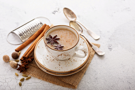 Foto de Masala tea in cup with winter spices - Imagen libre de derechos