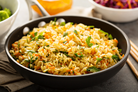 Photo pour Fried rice with vegetables and steamed broccoli - image libre de droit