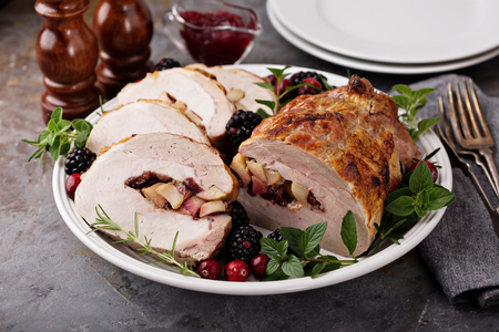 Photo for Roasted pork loin stuffed with apple and cranberry - Royalty Free Image