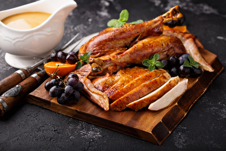 Photo for Carved turkey on a cutting board - Royalty Free Image