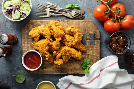Photo for Breaded chicken tenders with ketchup, salad and soda - Royalty Free Image