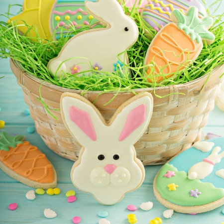 Photo for Easter cookies on blue table - Royalty Free Image
