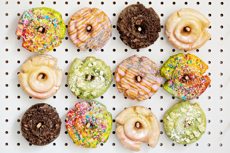 Photo for Variety of donuts on a peg board - Royalty Free Image