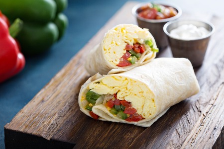 Photo for Vegetarian breakfast burrito with eggs - Royalty Free Image