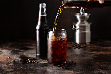 Foto de Cold brew iced coffee in glass bottles - Imagen libre de derechos